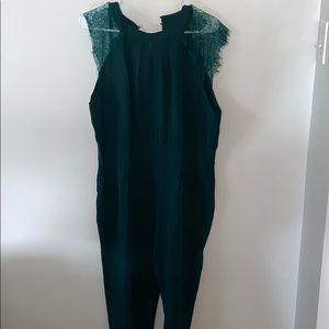 Women's dark green romper, long pant.